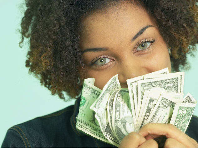 woman holding cash dollar bills