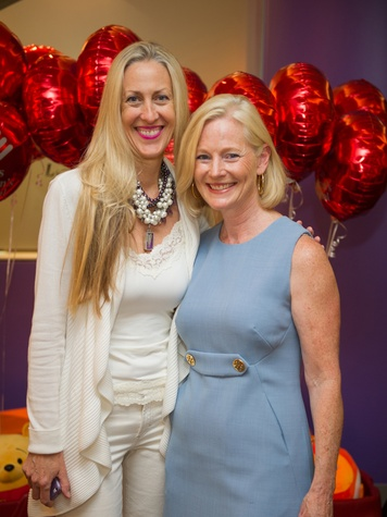 9546 Anita Kruse, left, and Trish Morille at the Lester and Sue Smith Clinic dedication at Texas Children's Hospital May 2014