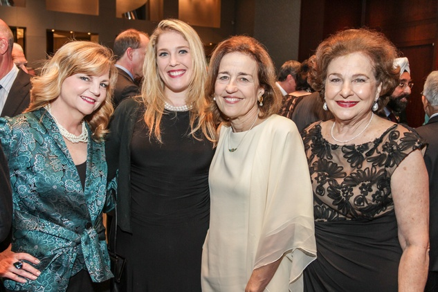 Kim Padgett, from left, Jennifer Roosth, Andrea White and Joann Crassas at the Interfaith Ministries Tapestry Gala May 2014