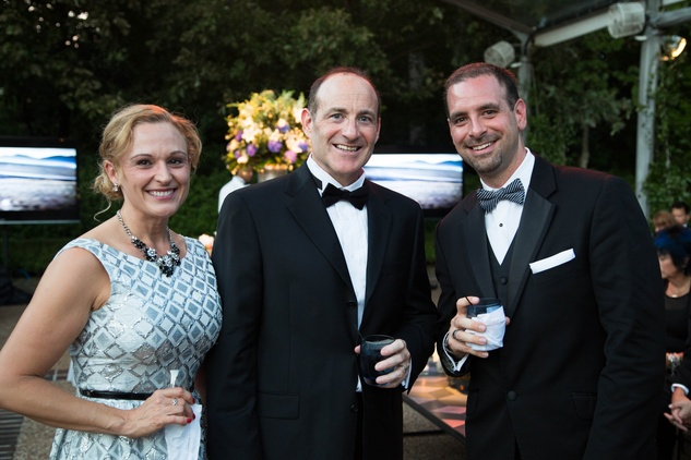 1 Angie and Paul DeWeese, from left, with Randy McCall at the Lamborghini party September 2014
