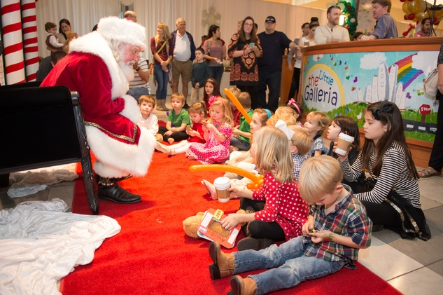 17 Santa telling Christmas tales to children at the M.D. Anderson Breakfast with Santa December 2014