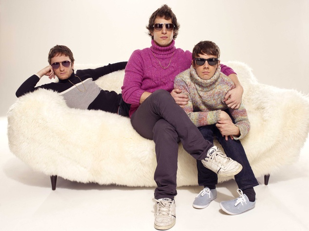 members of the Lonely Island sitting on a couche