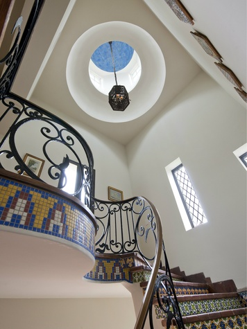 Light fixture over staircase