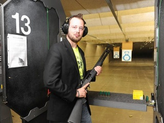 Kyle Coplen Armed Citizen Project with gun in shooting range