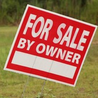 Land for sale by owner sign in empty lot property for sale