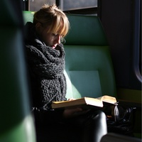woman reading reflection train