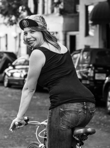 Girl on bike for Local Hub in Deep Ellum