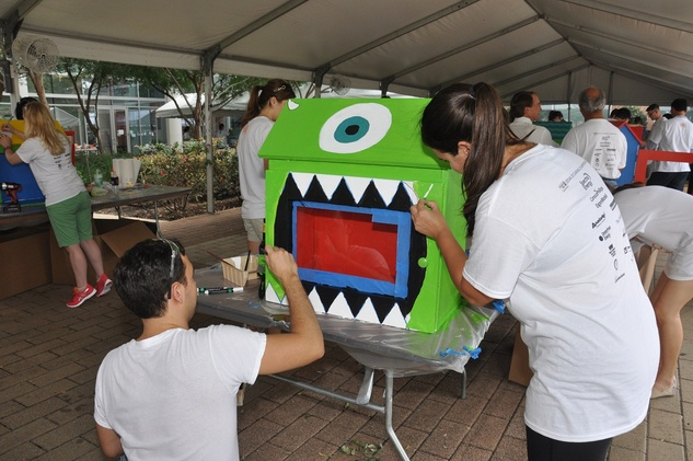 "17 A ""Monster's Inc."" themed tiny library at young professionals build Tiny Libraries September 2014"
