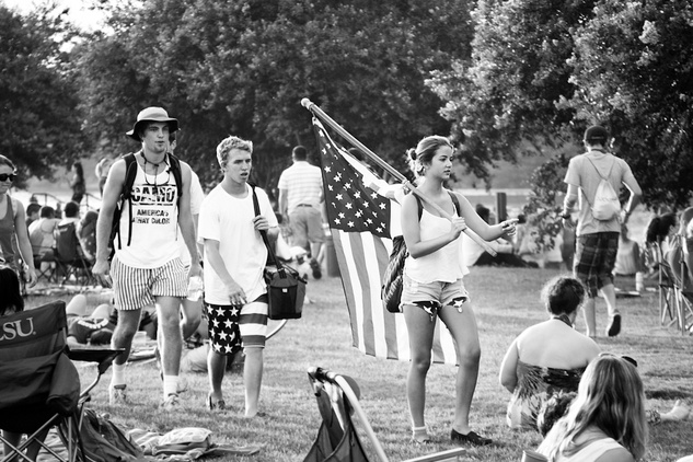Patriotic teens marched through the crowd, for a cozy spot on the grass.