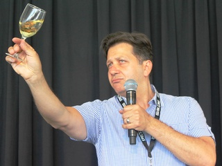 Anthony Giglio swirls wine in Underdog French