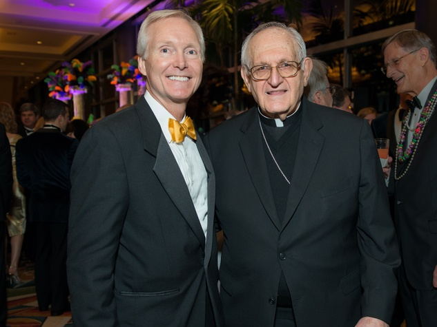5 Doug Sandvig and Archbishop Joseph A. Fiorenza at the St. Thomas Mardi Gras Gala February 2015