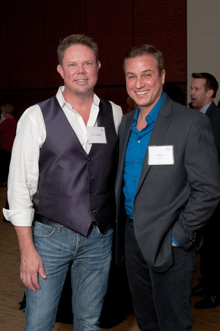 6 Dr. James Carroll, left, and Gilbert Perez at the World AIDS Day kick-off October 2014