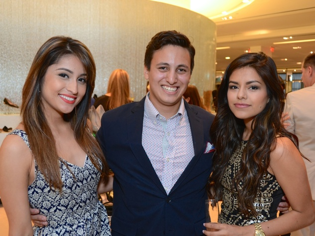 12 Noemi Serrano, from left, William Heartsill and Johanna Coronel at Fresh Faces of Fashion event at Tootsies September 2014