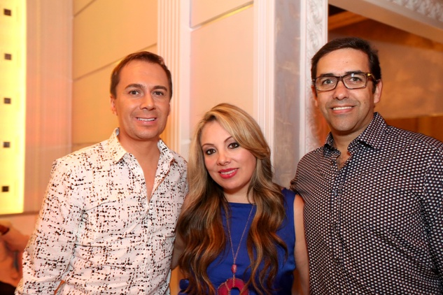 2797 Adrian Duenas, from left, Karen Hernandez-Lix and Marcelo Saenz at the Crimson grand opening party July 2014