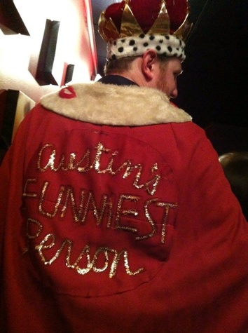 Mac Blake in crown and robe as Funniest Person in Austin 2013 winner