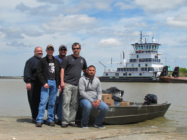 1. Katie Galveston oil spill Part 3 Interconnection April 2014 Capt. Dalen Cheramie (second from right) and crew