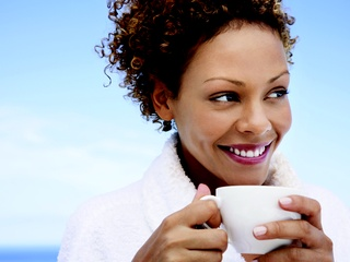 Girl holding coffee mug