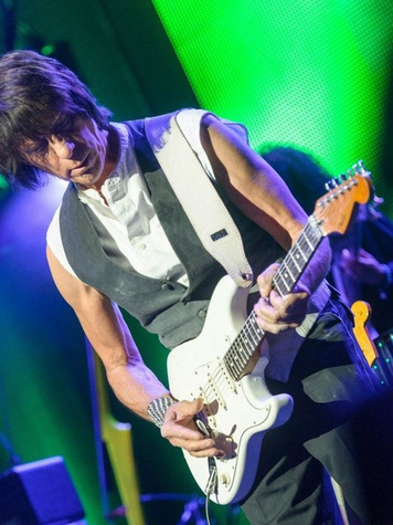 Jeff Beck playing guitar in concert