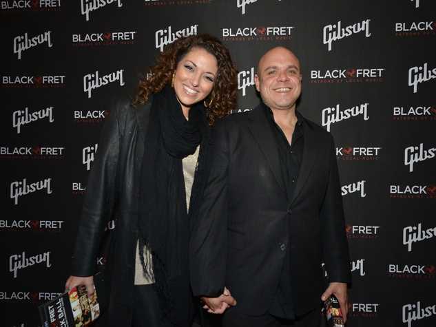 Gibson Black Ball Red Carpet Black Fret Advisory Board member Carlos Sola and guest