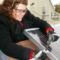 Austin Photo Set: News_Katherine_women in green jobs_april 2012_fixing solar panel