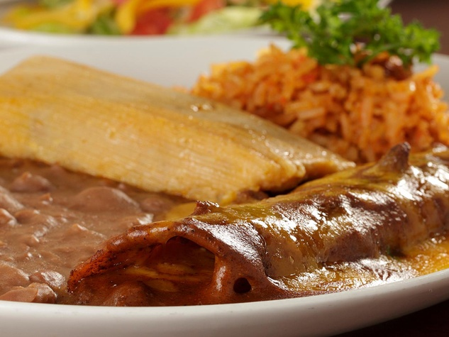 Mi Concina enchiladas, tamale and rice