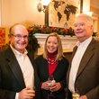 2063 24 John and Karen Vandy, from left, with Alec Mize at the Joiner holiday party December 2013