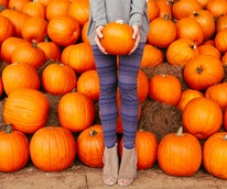 Women standing in a pumpkin patch