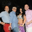 Clifford Pugh, from left, John Dascoulias, belly dancer and Brad Brandt at the Q The Salon Moroccan theme party September 2013