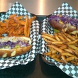 Sammy's Wild Game Grill buffalo sausage hot dogs with french fries and sweet potato fries