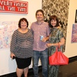 Christine West, from left, with Mark and Jenny Johnson at the Lawndale Big Show preview party July 2014