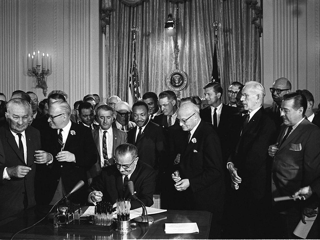 LBJ signing the Civil Rights Act on July 2, 1964