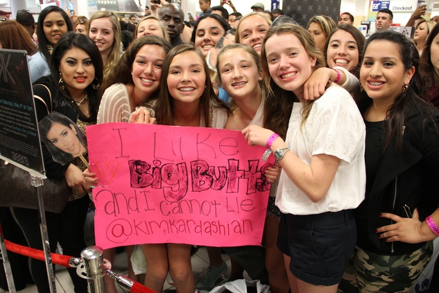 Kinkaid students with sign at Kardashian appearance at Sears Willowbrook Mall in Houston