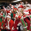 SantaCon New York City group posing in station