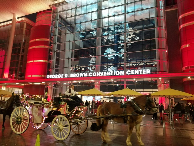 Horse drawn carriage in front of George R Brown Convention Center for Super Bowl kickoff