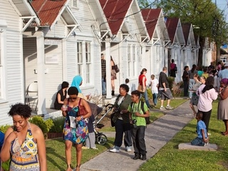 Project Row Houses with people walking outside day