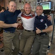 Flight Engineer Alexander Gerst poses with Commander Steve Swanson (left) and Flight Engineer Reid Wiseman dawning freshly shaved heads