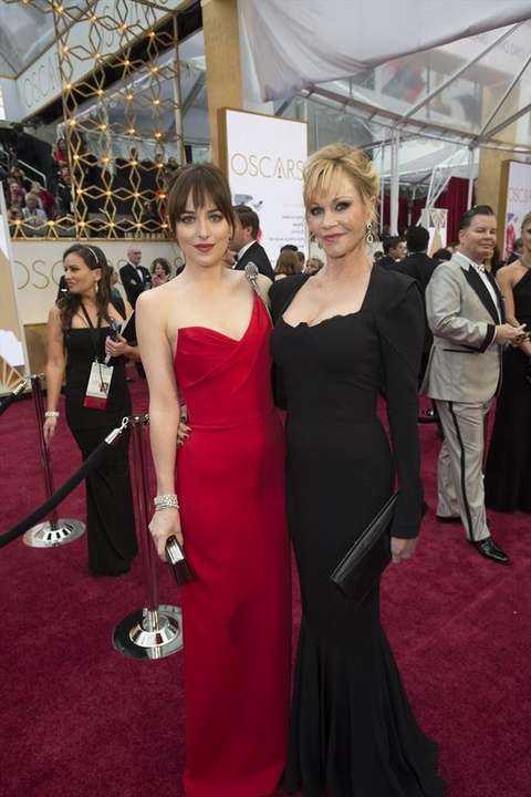 Dakota Johnson and Melanie Griffith on red carpet at Oscars
