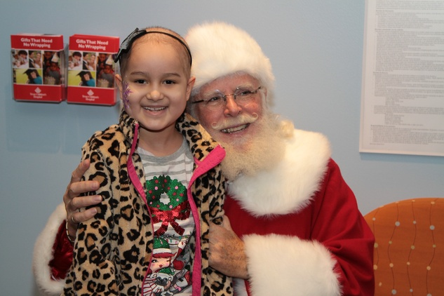 112 A patient poses with Santa at Santa visits Texas Children's Cancer Center December 2014