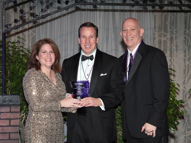 Stacey and Trey Wood, from left, with Roy Green at the Devereux Gala February 2014