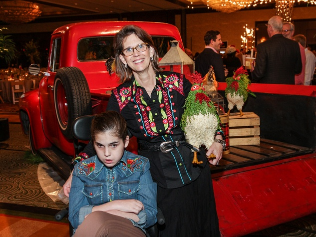 1 Elizabeth DeLuca, left, and daughter Caroline at Camp for All Gala March 2014
