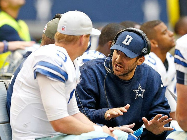 Tony Romo talks to Brandon Weeden at Cardinals game