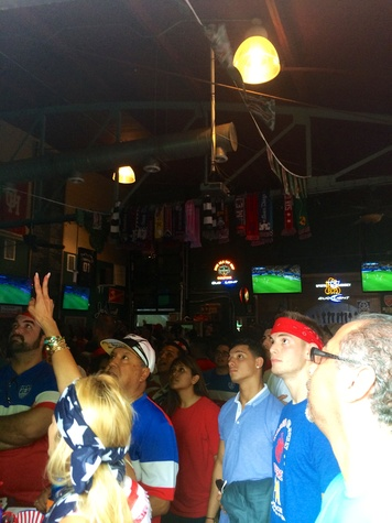Soccer fans in Lucky's Pub watching the USA vs. Belgium soccer game.