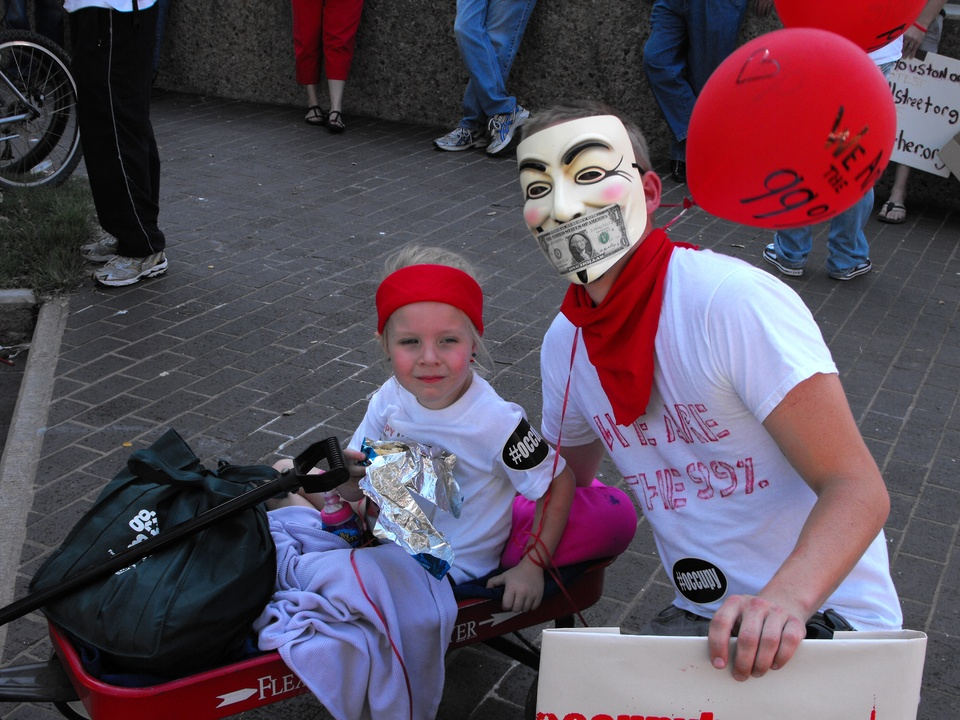 Occupy_Houston_Silent_Protest_Guy_Fawkes_and_kid