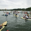 group of paddleboarders close together for Tyler's dam that cancer