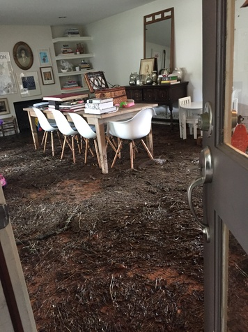 Debris in Houston Braes Heights home after flooding May 2015