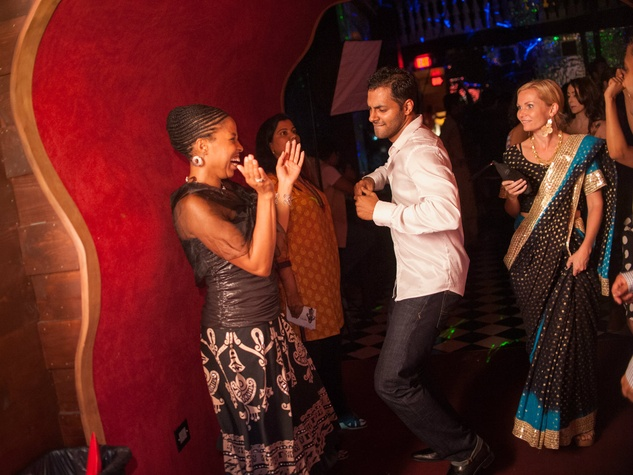 Joy Scott dances with friends in a velvet tunnel at Bollywood Ball