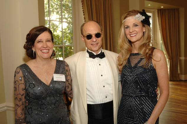 39 Gail Wood, from left, with Sam and Melinda Stubbs at the UH Law Center Gala April 2014