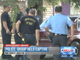 eight people found held captive in Houston home July 2013 RUN FLAT