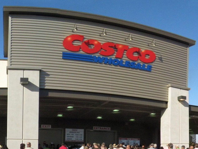 Costco store sign with people in front