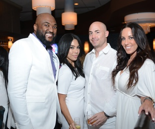 107 Michael Tyler, from left, Vanessa Chavez, Charlie Kriegel and Jen Hovas at the White Hot Summer Night Party at Eddie V's August 2014